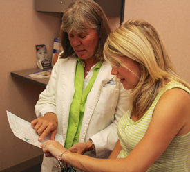 Nurse practitioner with female patient