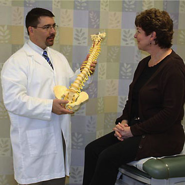 Orthopedic nurse practitioner with patient
